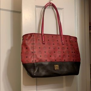 MCM raspberry colored tote and purse/shoulder bag